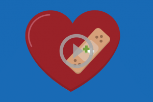 red heart with bioplus bandage on blue background